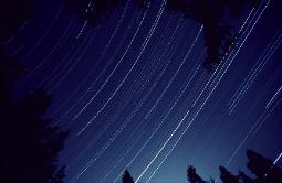 Star trails - leaving the camera shutter open for five hours that records the stars apparent movement from earth's rotation
