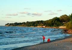 Lake Erie's Huntington Beach State Park with two people in red picking up beach glass