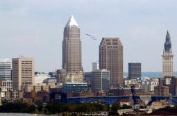 Photograph of the Navy Blue Angels flying over the skyline of Cleveland, Ohio
