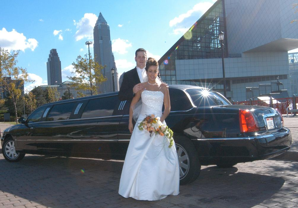 Bride and Groom ni front of limousine at the Rock and Roll Hall of Fame