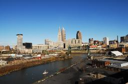 Downtown Cleveland, Ohio skyline on a bright sunny day from the Lorain Carnegie Bridge featuring the Cuyahoga River