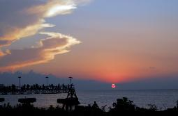 Edgewater Park Sunset - dramatic sunset over Lake Erie west of Cleveland with Edgewater State Park's pier full of people