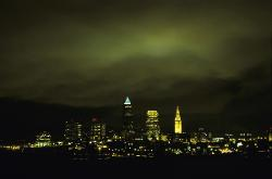 Downtown Cleveland, Ohio at night with low cloud cover lighted up green