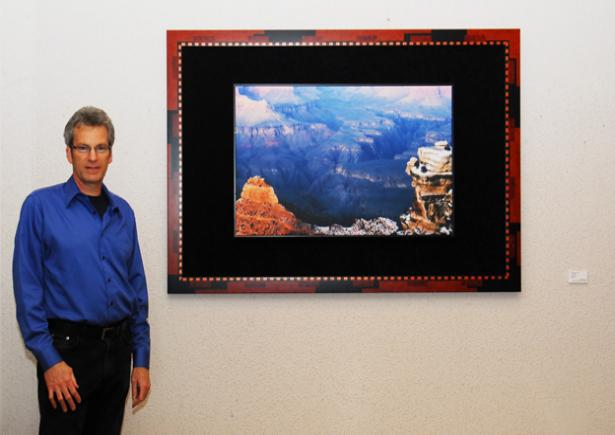 Me, Kurt Shaffer standing next to framed print of The Grand Canyon