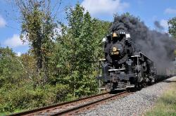 photograph of the old black antique engine of the Cuyahoga Valley Line train with billowing black smoke
