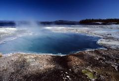 Hot spring thermal pool of Yellowstone National Park steaming