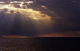 Beautiful sun rays shining down from clouds over Lake Erie, the Great Lakes