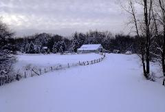 Beautiful and serene winter scene of rural Ohio with fence and barn