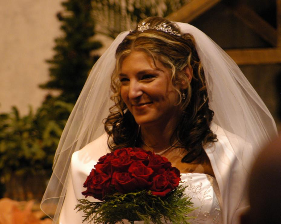 Beautiful bride with boquet of red roses